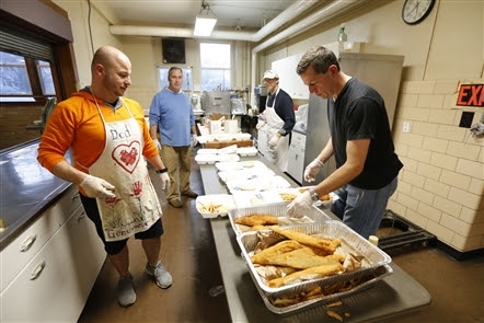 Holy Name Society Makes their Name in Fish Fry Dinners!